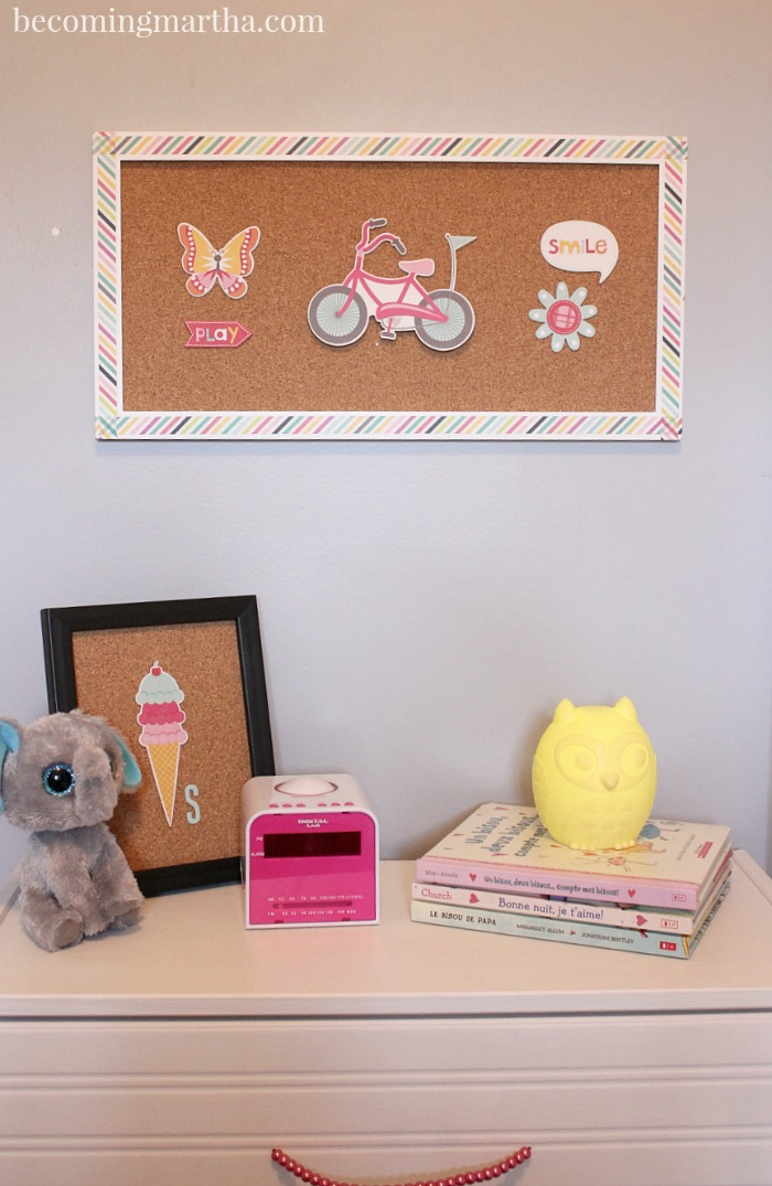 This adorable kids room wall art was created using an old frame, cork roll, and chipboard scrapbooking stickers!