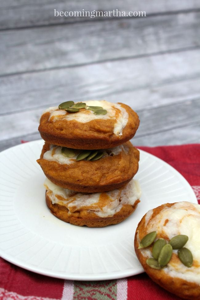 These pumpkin muffin tops with a cream cheese swirl are full of yummy autumn goodness!