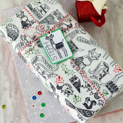 This coloring gift wrap is a creative way to wrap your gifts this Christmas (or anytime of year) and can be created with the Cricut Explore or Maker!